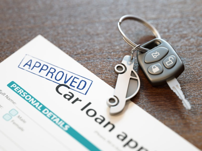approved car loan application with car key