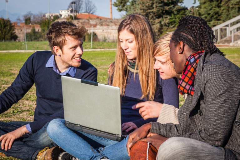 young adults with laptop