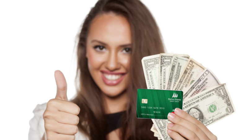 Girl holding a credit card and cash